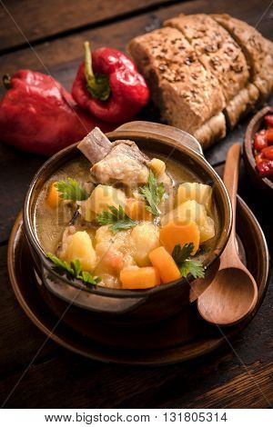Photos of stew soup on rustic background