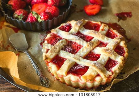 Tart cake with strawberries on rustic background