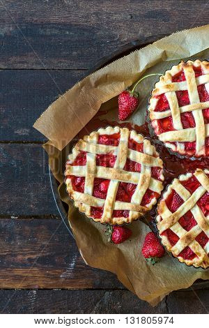 Tart cake with strawberries sauce on rustic background