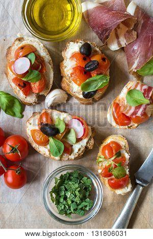 Photos of tasty bruschettas on rustic background