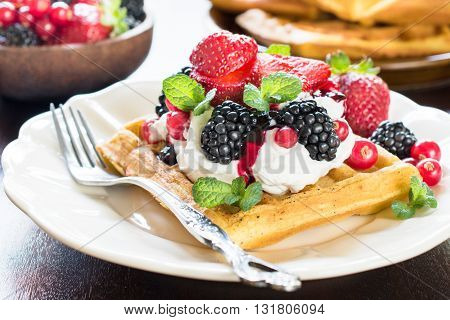 Photos of tasty waffles on rustic background