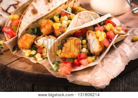 Photos of tortilla time on rustic background