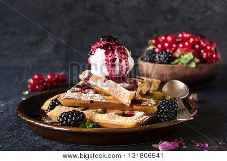 Waffles and ice cream on rustic background