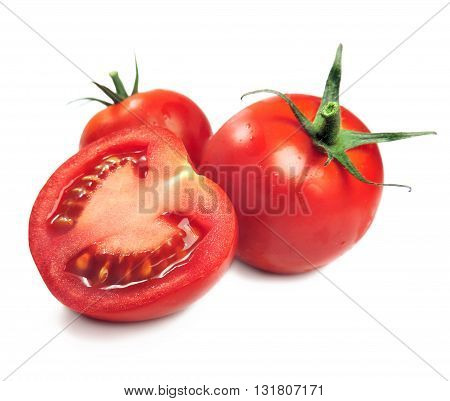 Fresh tomatoes and tomato slice, isolated on white.