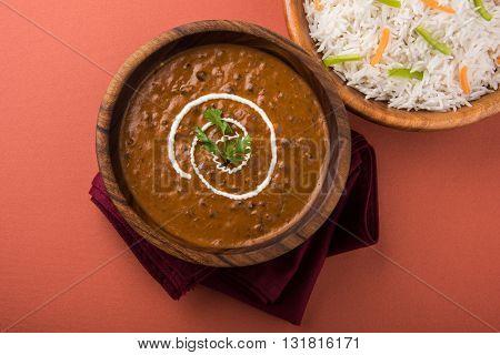 dal makhani or daal makhani or dal makhni with plain basmati rice, served in wooden bowl