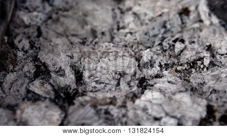 Extinct ashes after burning fire detailed texture background