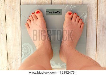 Feet On Scales With Text You Are Beautiful In French Language
