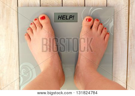 Feet On Scales With Text Help In English Language