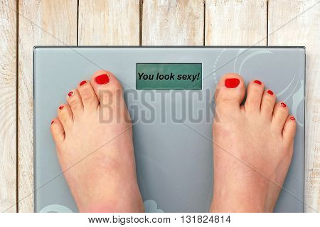 Feet On Scales With Text You Look Sexy In English Language.