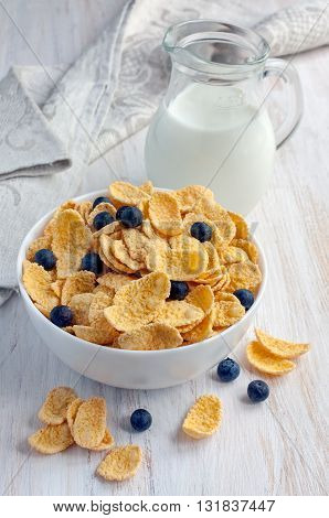 Corn Flakes With Blueberries And Jug Of Milk