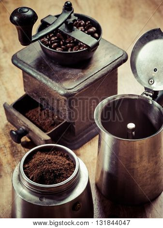Photo of an Italian Moka Express stovetop coffee maker and a coffee grinder
