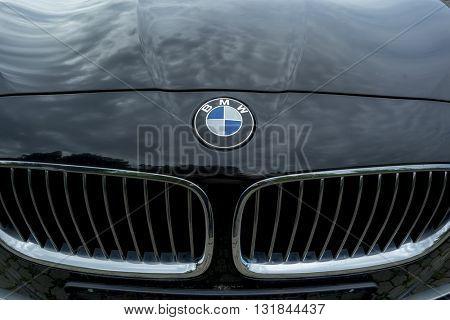 BADEN-BADEN, GERMANY - MAY 29, 2016: A BMW logo on a black car body