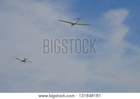 TEHACHAPI, CA - MAY 28, 2016: A Grob G103 Twin Astir two-place sailplane gets a tow to altitude during the Western Vintage/Classic Regatta at Mountain Valley Airport.