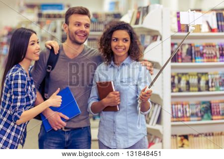 Students With Gadget At The Bookshop