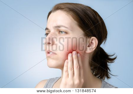 A young woman suffering from a toothache