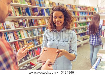 Girl With Credit Card At The Bookshop