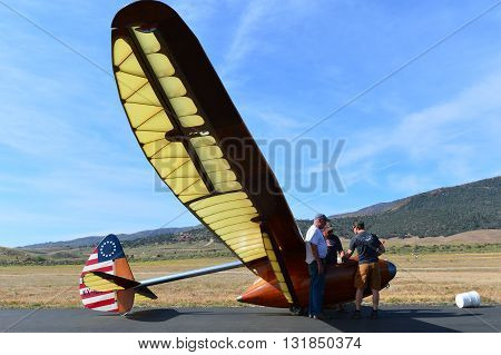 TEHACHAPI, CA - MAY 28, 2016: Jeff Byard (white shirt) prepares to fly his beautiful Bowlus BA-100 Baby Albatross glider during the Western Vintage/Classic Regatta at Mountain Valley Airport.