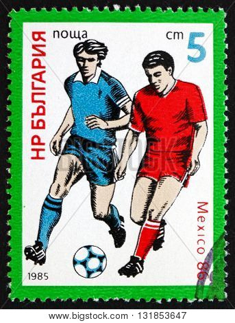 BULGARIA - CIRCA 1985: a stamp printed in the Bulgaria shows Soccer Players 1986 World Cup Soccer Championships Mexico circa 1985