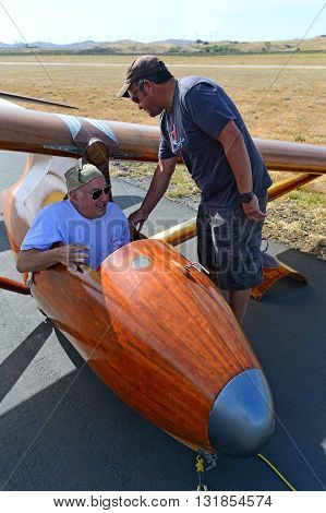 TEHACHAPI, CA - MAY 28, 2016: Jeff Byard squeezes into the small cockpit of his BA-100 Baby Albatross glider during the Western Vintage/Classic Regatta at Mountain Valley Airport.