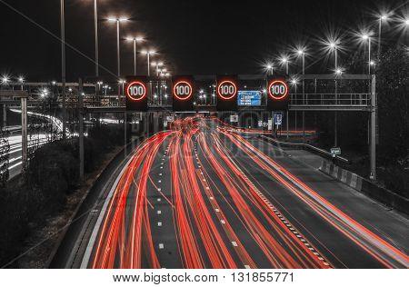 Night highway in Antwerp, Belgium. Тight traffic,