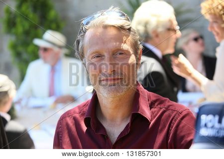 CANNES, FRANCE - MAY 20: Mads Mikkelsen attends the Mayor's lunch given in honour of the media at Place de la Castre during the 69th Cannes Film Festival on May 20, 2016 in Cannes, France.
