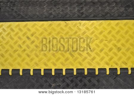 close-up of the black-yellow speed bumps Humps