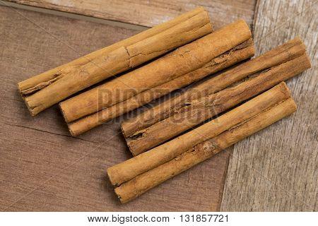 Cinammon bark or sticks on a wooden board