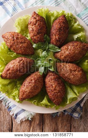 Arabic Kubbeh Tasty Meatballs Close Up On A Plate. Vertical Top View
