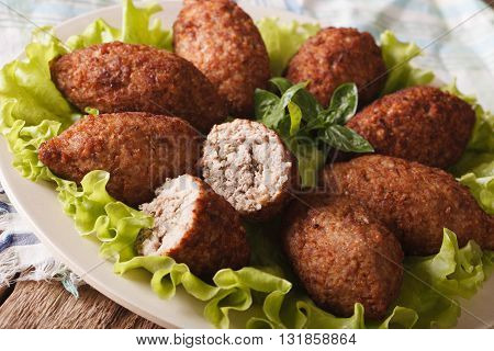 Delicious Spicy Kubbeh With Bulgur, Onion And Pine Nuts Macro. Horizontal