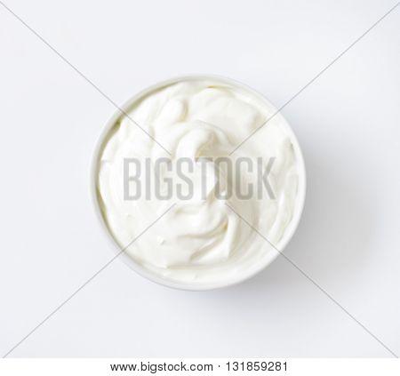 bowl of white yogurt on white background