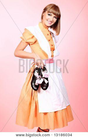 Portrait of a beautiful housewife. Studio shot.