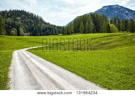 Beautiful landscape of valley in Alpine mountains, small houses in Seefeld, rural scene, majestic picturesque view in sunny day poster