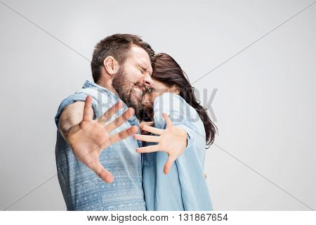 Emotional facial expression of woman an man on gray