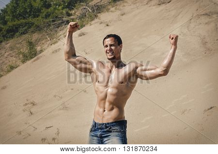 The guy brawny poses on a belt is undressed. The guy blyunt with blue eyes