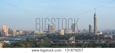 Cairo Egypt - May 22 2016: Central Cairo skyline at dusk the Nile river the Island of Zamalek and the 6th October Bridge.