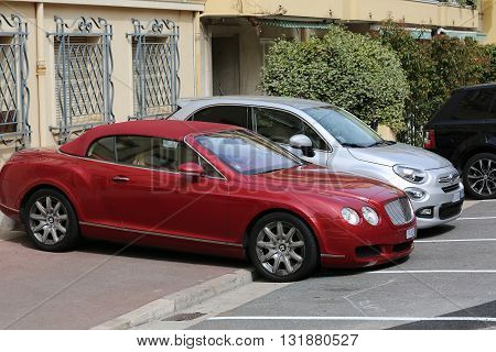 Monte-Carlo Monaco - May 28 2016: British Luxury Car Bentley Continental GTC Badly Parked on the Sidewalk in Monaco