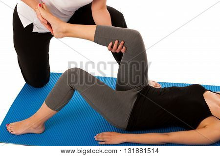 Physiotherapy - Therapist Doing   Leg Stretching Excercises With A Patient To Recover  After Injury