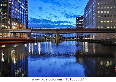 View of Middle Dock at Canary Wharf in London at dusk United Kingdom