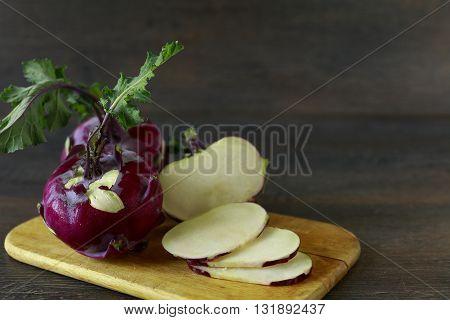 Sliced purple kohlrabi on the wooden kitchen board