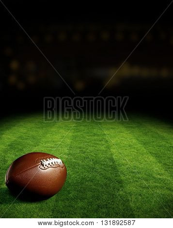 American football on green field stadium at night