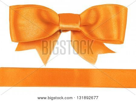 Orange bow and ribbon isolated on white