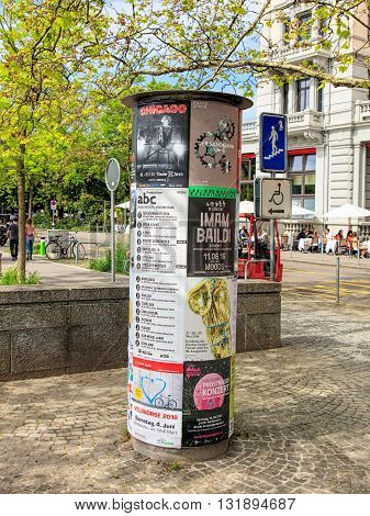 Zurich, Switzerland - 26 May, 2016: theater playbills on the Limmatquai quay, people in the background. Zurich is the largest city in Switzerland and the capital of the Swiss canton of Zurich.