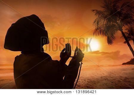 Silhouette Of Muslim Woman Praying