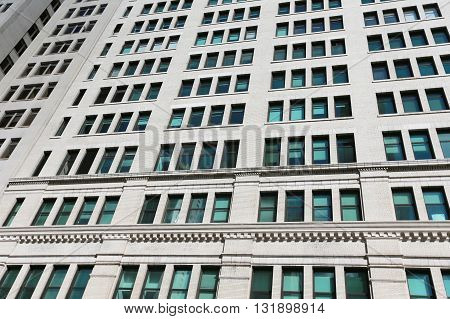 Classic style building facade with a lot of windows