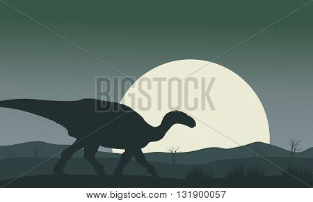 Silhouette of Iguanodon with moon a very beautiful