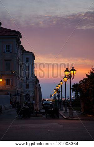 View of street lantern illuminated in Trieste Italy