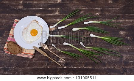 Egg chives plate knife and fork look like sperm competition Spermatozoons floating to ovule . Close up