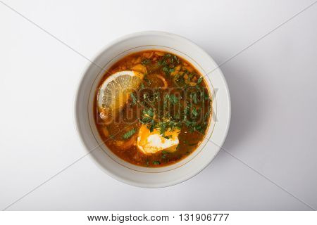 Traditional russian soup solyanka with sour cream
