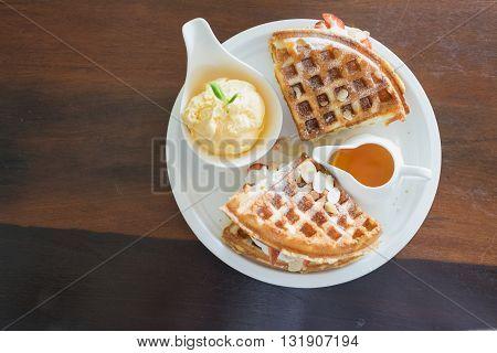 waffle with syrup waffle with ice-cream waffle with strawberry waffle with whip cream waffle on wooden table yummy waffle fresh waffle / ice cream waffle strawberry waffle baked waffle fresh waffle