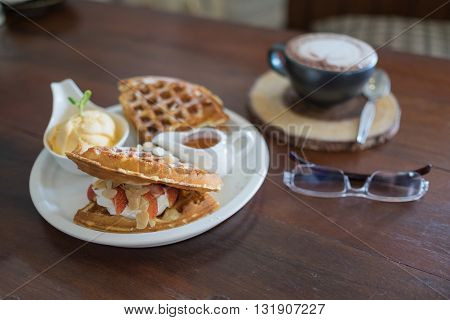 waffle with syrup waffle with ice-cream waffle with strawberry waffle with whip cream waffle on wooden table yummy waffle fresh waffle hot coffee with waffle waffle with glasses / ice cream waffle strawberry waffle baked waffle fresh waffle hot coffee and